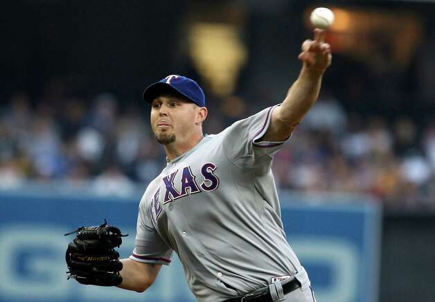 Texas Rangers starting pitcher Matt Harrison works against the San Diego Padres during the first inning of an interleague baseball game, Monday, June 18, 2012, in San Diego. Photo: Lenny Ignelzi, Associated Press