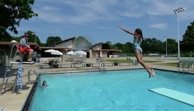 Kyleigh Giancony, 10 of Glenmont dives in the water at the Elm Avenue Park pool in Bethlehem, N.Y. June 18, 2012.     (Skip Dickstein / Times Union) Photo: SKIP DICKSTEIN