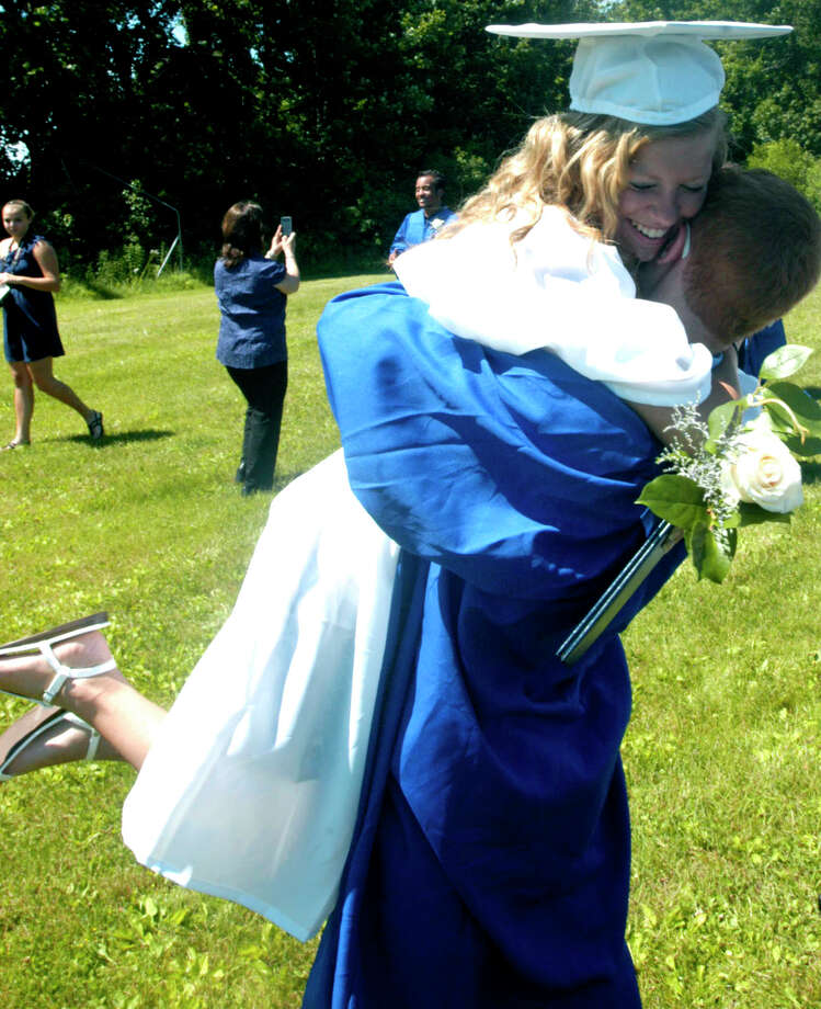 Marissa Pitts and Cody Brennan share a celebratory hug moments after the Shepaug Valley High School graduation ceremony, June 16, 2012, in Washington. Photo: Norm Cummings