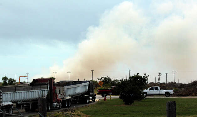 Smoke flows from a compost fire Tuesday morning, June 19, 2012, from the New Earth composting facility at 7800 IH-10 east near Foster Road. The fire started about 9 p.m. Monday night and the cause of the blaze is still being investigated. No injuries have been reported. Photo: John Davenport, San Antonio Express-News