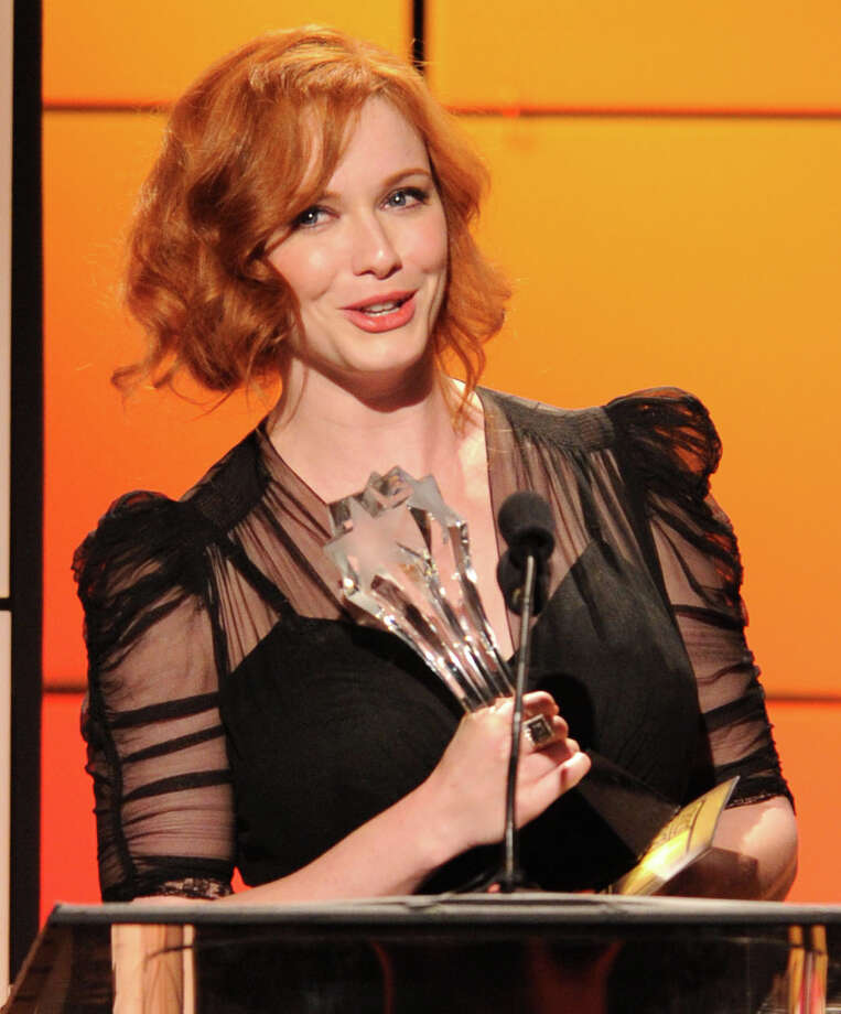 "Christina Hendricks accepts the award for best supporting actress in a drama for ""Mad Men"" onstage at the 2nd Annual Critics' Choice Television Awards at the Beverly Hilton Hotel on Monday. Photo: VINCE BUCCI/INVISION/AP"