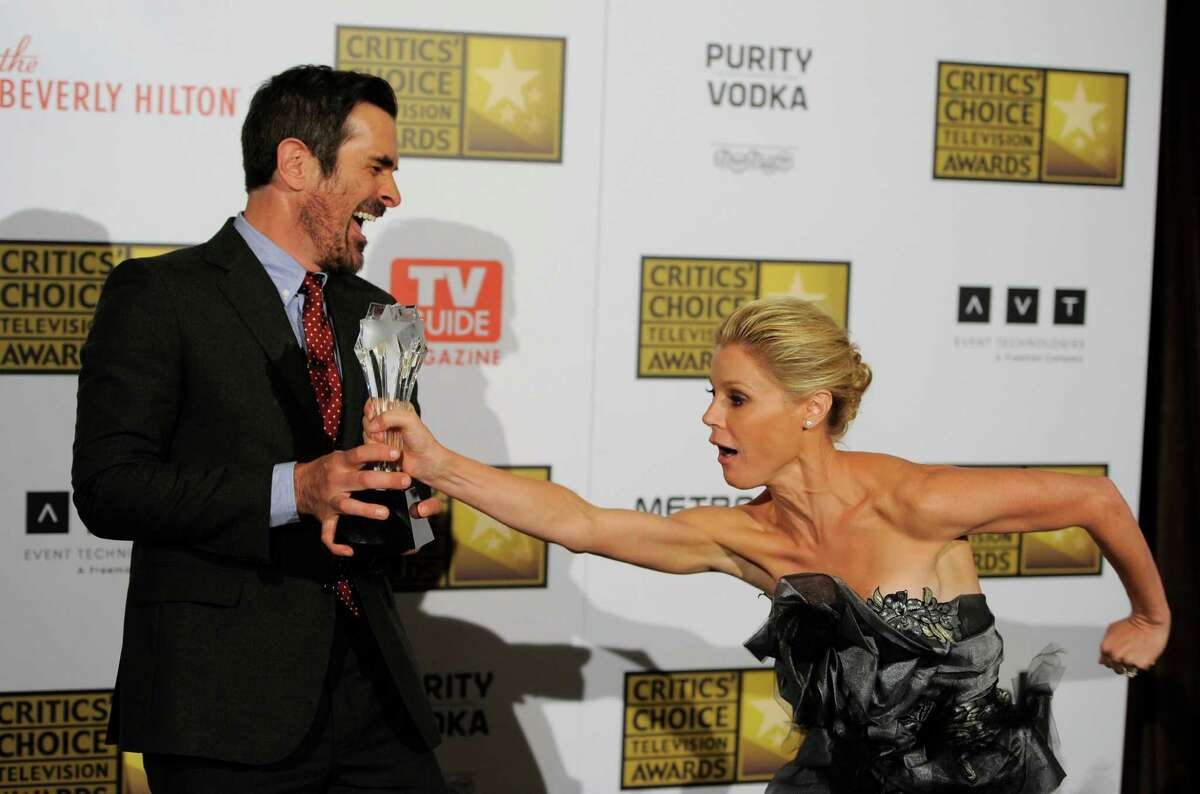 Ty Burrell, left, winner of the award for best supporting actor in a comedy series, and Julie Bowen, winner of the award for best supporting actress in a comedy series, pose backstage at the 2nd Annual Critics' Choice Television Awards at the Beverly Hilton Hotel on Monday in Beverly Hills.