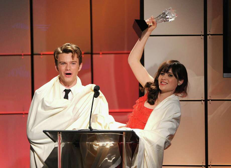 Presenters Chris Colfer (L) and Zooey Deschanel onstage during The Broadcast Television Journalists Association Second Annual Critics' Choice Awards at The Beverly Hilton Hotel on Monday.  Photo: Kevin Winter, Getty Images For Critics Choice / 2012 Getty Images