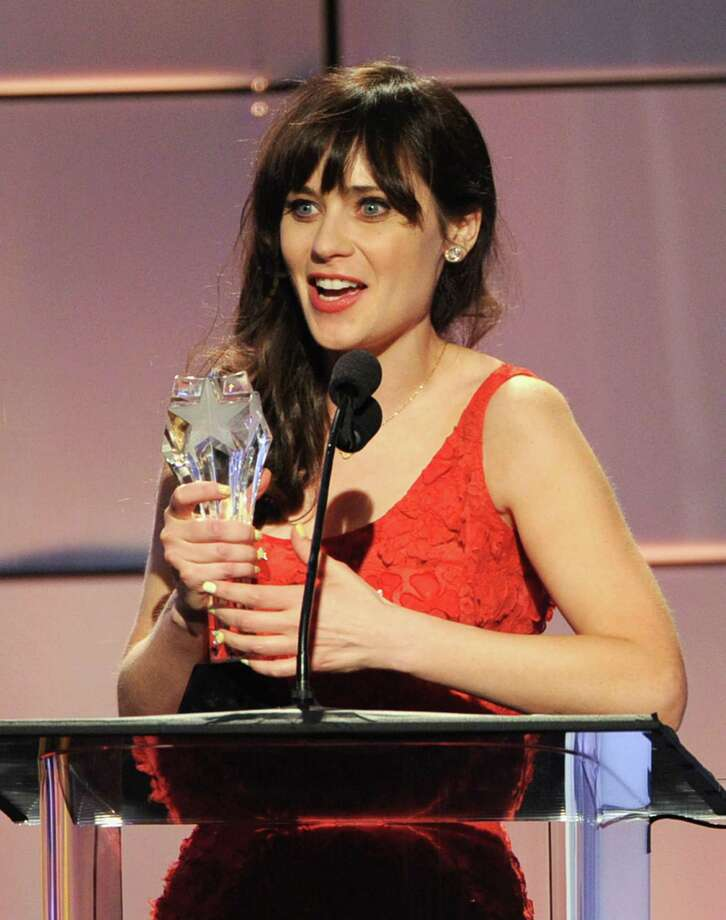 Zooey Deschanel accepts the award for Best Comedy Actress onstage during The Broadcast Television Journalists Association Second Annual Critics' Choice Awards at The Beverly Hilton Hotel on Monday. Photo: Kevin Winter, Getty Images For Critics Choice / 2012 Getty Images
