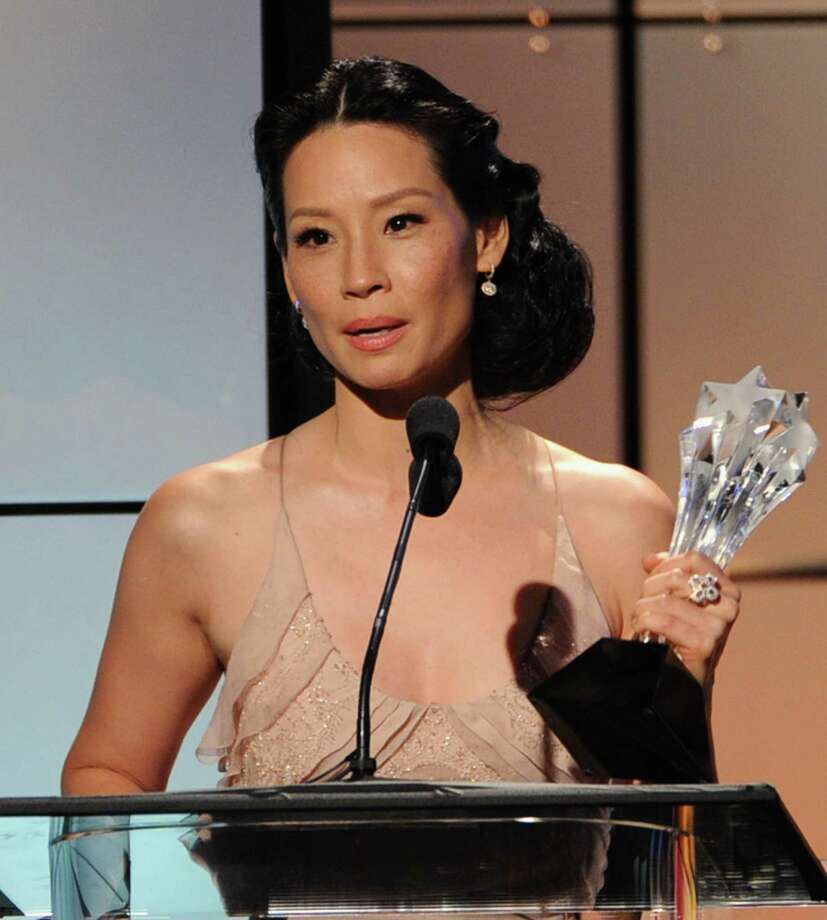 Presenter Lucy Liu accepts the award for Best Reality Show Host on behalf of Tom Bergeron onstage during The Broadcast Television Journalists Association Second Annual Critics' Choice Awards at The Beverly Hilton Hotel on Monday. Photo: Kevin Winter, Getty Images For Critics Choice / 2012 Getty Images