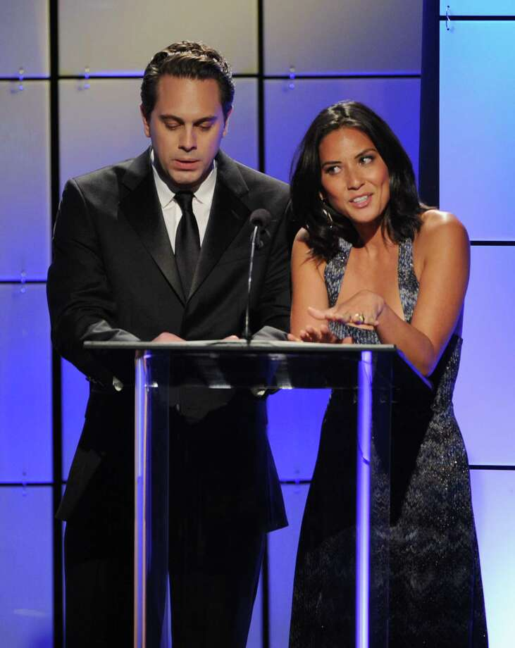 Actors Thomas Sadoski (L) and Olivia Munn speak onstage during The Broadcast Television Journalists Association Second Annual Critics' Choice Awards at The Beverly Hilton Hotel on Monday. Photo: Kevin Winter, Getty Images For Critics Choice / 2012 Getty Images