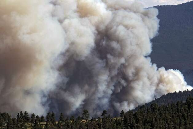 Smoke billows from the High Park Fire west of Fort Collins, Colo., on Monday,  June 18, 2012. The wildfire has now burned about 90 square miles and destroyed more than 180 homes.  (AP Photo/Ed Andrieski) Photo: Ed Andrieski, Associated Press