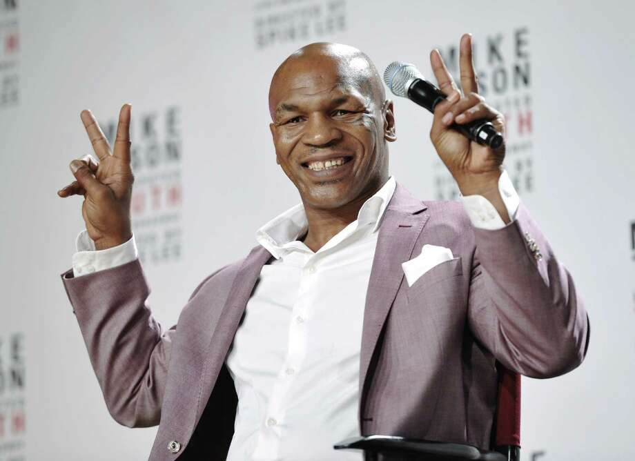 "Former heavyweight boxer Mike Tyson announces ""Mike Tyson: Undisputed Truth"" a one man show on Broadway Monday June 18, 2012 in New York. (Photo by Evan Agostini/Invision) Photo: Evan Agostini, EVAN AGOSTINI/INVISION/AP / 2012 Invision"
