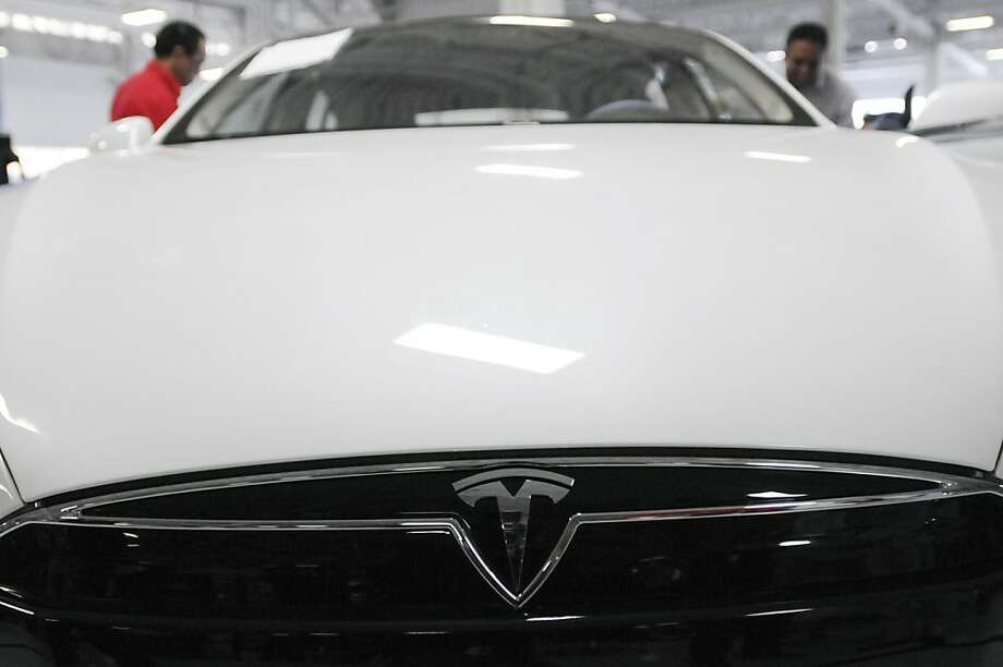 A completed Tesla Model S sedan sits at the end of the assembly line at Tesla's factory in Fremont, Calif., Wednesday, June 13, 2012. Photo: Erik Verduzco, Special To The Chronicle