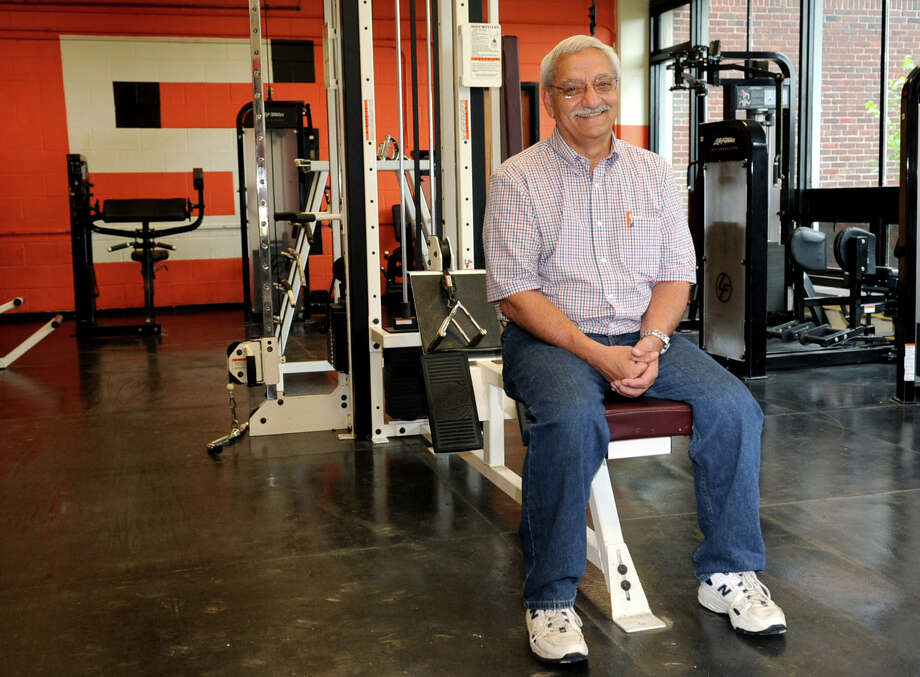 Pete Samperi poses for a photo in the weight room at Stamford High School on Tuesday, June 19, 2012. Samperi is retiring this year from his position as Athletic Director for the school. Photo: Lindsay Niegelberg / Stamford Advocate