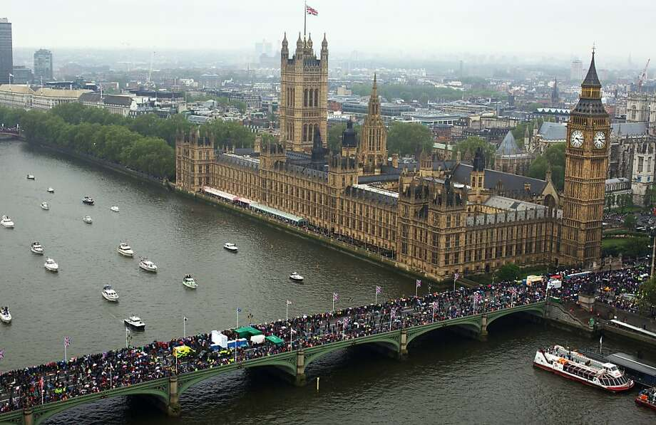 Aerial view shows spectators crowding Westminster Bridge watching of the 1,000 vessels of all shapes and sizes sailing down the River Thames during the Diamond Jubilee river Pageant in London on June 3, 2012. Britain's Queen Elizabeth II sails on a royal barge down the River Thames as part of a huge pageant marking her diamond jubilee, in one of the biggest events of its kind in London's history.      AFP PHOTO / ANDREW COWIEAndrew Cowie/AFP/GettyImages Photo: Andrew Cowie, AFP/Getty Images