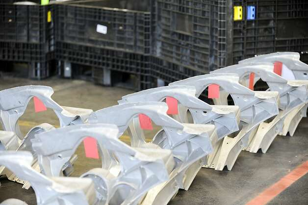 Assembly parts are lined up to be assembled at the Tesla factory in Fremont, Calif., Wednesday, June 13, 2012. On June 22, Tesla Motors will begin delivering its all-electric Model S luxury sedan. It is only the second car ever produced by Tesla, and first to be built at Tesla's own factory. Photo: Erik Verduzco, Special To The Chronicle