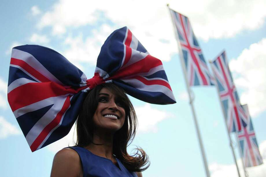 A race-goer wearing a flamboyant hat poses for the media at the annual Royal Ascot horse racing event near Windsor, Berkshire on June 19, 2012. The five-day meeting is one of the highlights of global horse racing and the pinnacle of the English social calendar. AFP PHOTO / CARL COURTCARL COURT/AFP/GettyImages Photo: CARL COURT, AFP/Getty Images / AFP