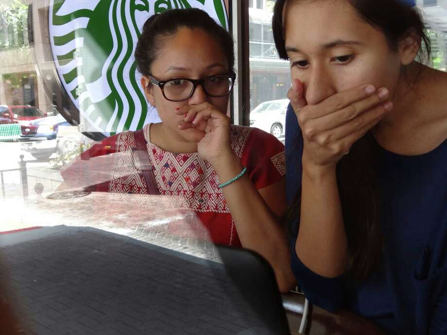 Watching an Internet broadcast in San Antonio,  two illegal immigrants react with joy and disbelief at the president's announcement regarding undocumented individuals who arrived here as children. Among readers, the response was more diverse. Photo: Billy Calzada, San Antonio Express-News / © 2012 San Antonio Express-News