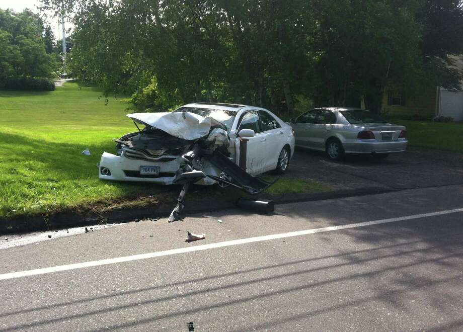 An unidentified woman was hospitalized Monday afternoon, June 18, 2012 after a two-car crash on Easton Turnpike in Fairfield, Conn., police said. The woman was driving a white sedan that collided with a tan Jeep sport utility vehicle driven by another woman. Both cars sustained front-end damage, though the damage to the sedan was more severe. Photo: Tom Cleary