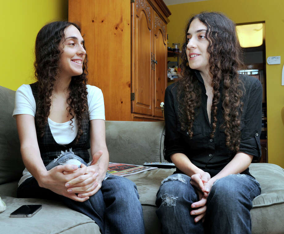 Camila, left, and Carolina Bortolleto, 24-year-old twins, talk about the Dream Act in their home in Danbury, Tuesday, June 19, 2012. Photo: Carol Kaliff