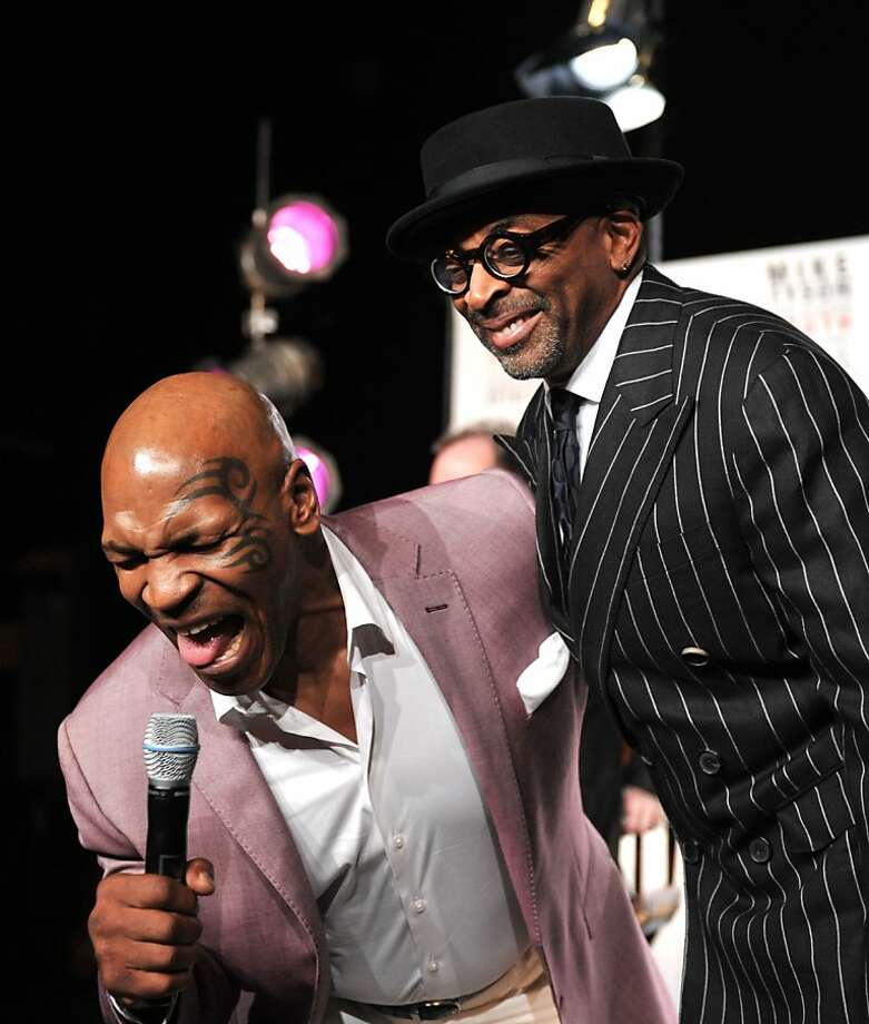 "Former boxing heavyweight champion Mike Tyson (L) sings with director Spike Lee (R) before a press conference on June 18, 2012 announcing that Tyson will star on Broadway in an autobiographical one-man show called ""Mike Tyson: Undisputed Truth"" at the Longacre Theater in New York. Lee will direct the show which will run for six nights from July 31.    AFP PHOTO/Stan HONDASTAN HONDA/AFP/GettyImages Photo: Stan Honda, AFP/Getty Images"