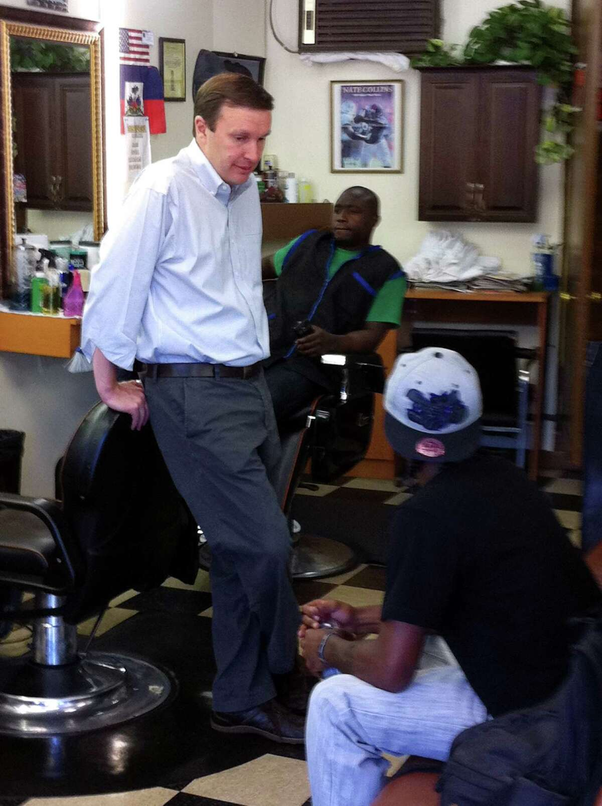 U.S. Rep. Christopher Murphy talks to Dayvon Kearney of Stamford, a student at Total Image Beauty and Barber in Stamford, Conn. as part of a campaign jobs tour on Monday June 18, 2012. Murphy is the endorsed Democratic candidate for U.S. Senate. He faces an August primary against Susan Bysiewicz.
