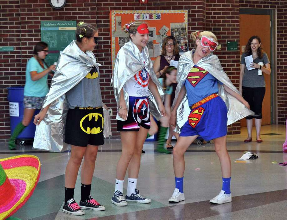 Team Free Falliní shows off their festive costumes: Erin Karczewski, Paige Whitney, Katie Cronin at Middlesex Middle School in Darien Conn. Photo: Contributed Photo