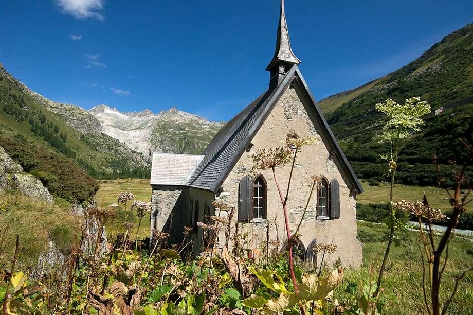 A small church in the Goms region of Valais, below the Rhone Glacier. Switzerland. Photo: Lance Richardson