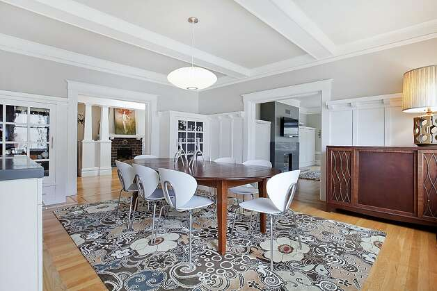 The family room opens into the formal dining room. Photo: OpenHomesPhotography.com