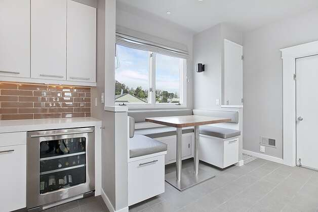 The kitchen also has a casual breakfast nook. Photo: OpenHomesPhotography.com