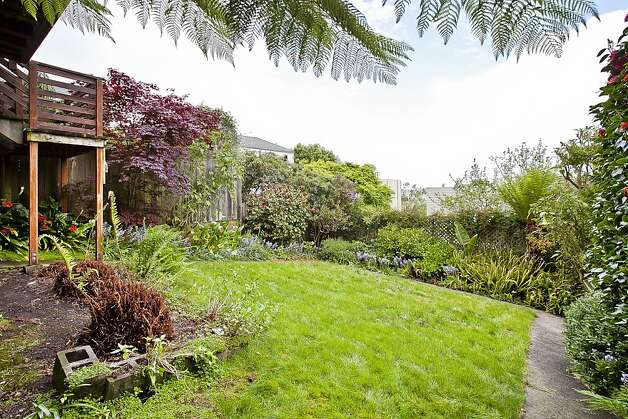 The home has a shared landscaped backyard. Photo: OpenHomesPhotography.com