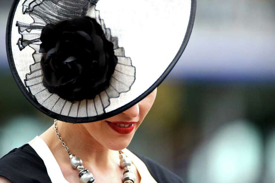 ASCOT, ENGLAND - JUNE 19:  Racegoers attend day 1 of Royal Ascot at Ascot Racecourse on June 19, 2012 in Ascot, England. Photo: Ben Pruchnie, Getty Images / 2012 Getty Images