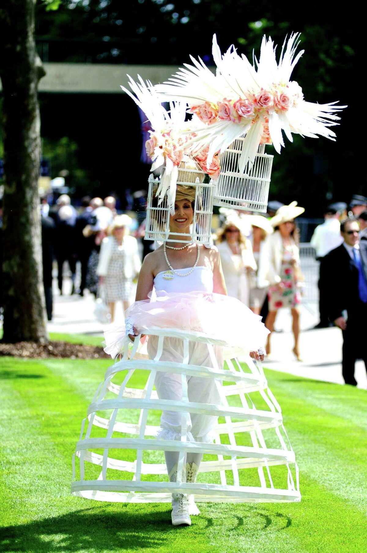 ASCOT, ENGLAND - JUNE 19: Racegoers attend day 1 of Royal Ascot at Ascot Racecourse on June 19, 2012 in Ascot, England.