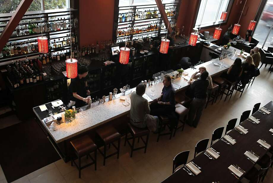 96 Hours Bar Bites feature the scene, people, food and drink at Dosa on Fillmore in San Francisco. This is a restaurant that has a large lounge area to the right and full dining room on the left, separated by a low wall. Photo: Carlos Avila Gonzalez, The Chronicle