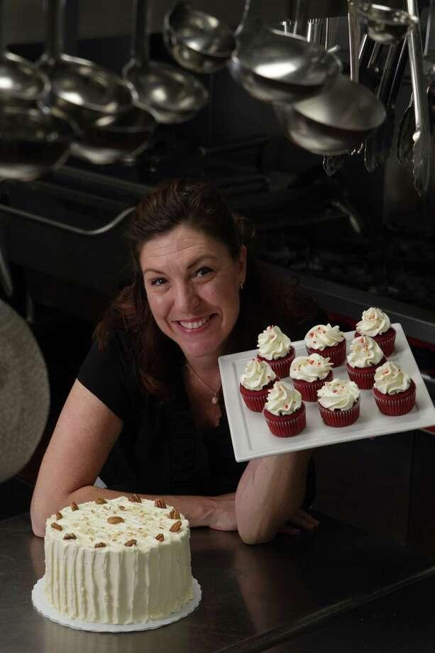 Jody Stevens baked her Hummingbird Cake and Red Velvet cupcakes using agave nectar. Photo: Brett Coomer / © 2012 Houston Chronicle
