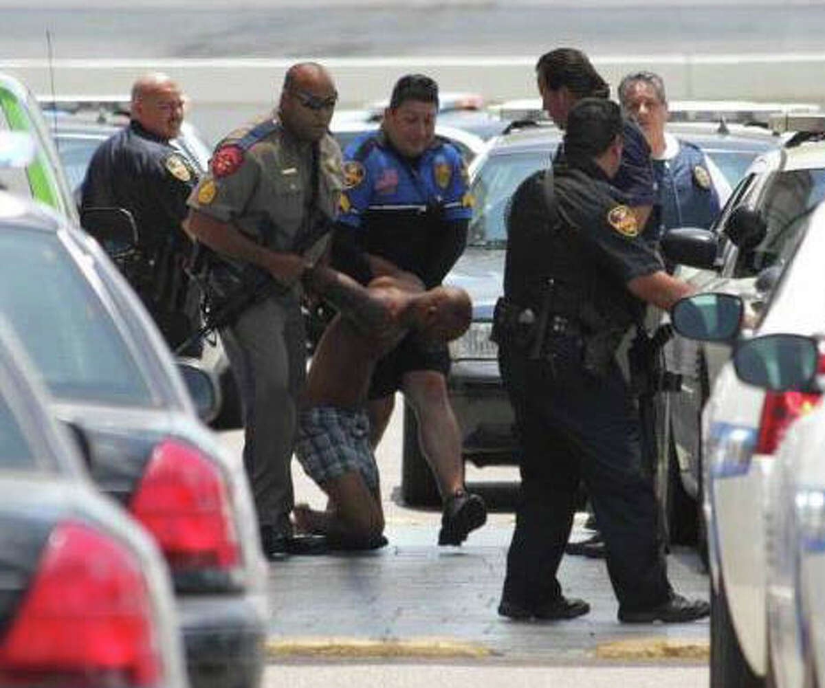 Demond Bluntson is detained after police said he fatally shot an infant and critically injured a 6-year-old in the Holiday Inn-Civic Center in Laredo on Tuesday, June 19, 2012.