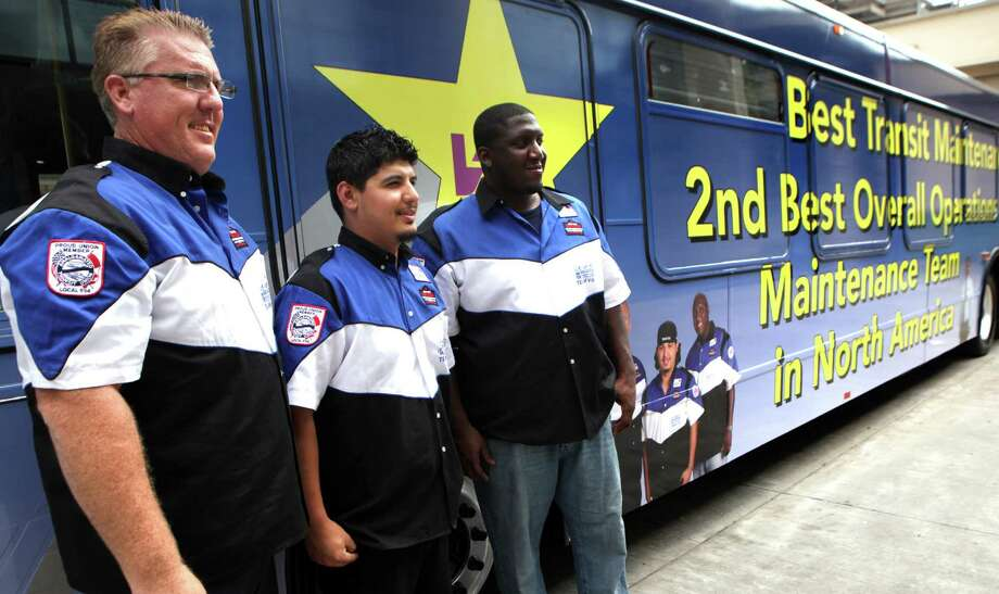 Phil Davis (from left), Hugo Villarreal and Marcel Longmire pose for photos Tuesday, June 19, 2012, at the unveiling of a VIA Metropolitan Transit bus announcing their win at the American Public Transportation Association International Bus Roadeo. Photo: BOB OWEN, San Antonio Express-News / © 2012 San Antonio Express-News