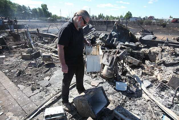 Clyde Charbonneau looks over what is left of his home in Mountain Home, Idaho, Tuesday June 19, 2012 after a blaze destroyed his residence and two other structures on his property. The fire, which started Monday evening, has burned 150 acres, destroyed six residences and several outbuildings. (AP Photo/The Idaho Statesman, Chris Butler)  MANDATORY CREDIT Photo: Chris Butler, Associated Press
