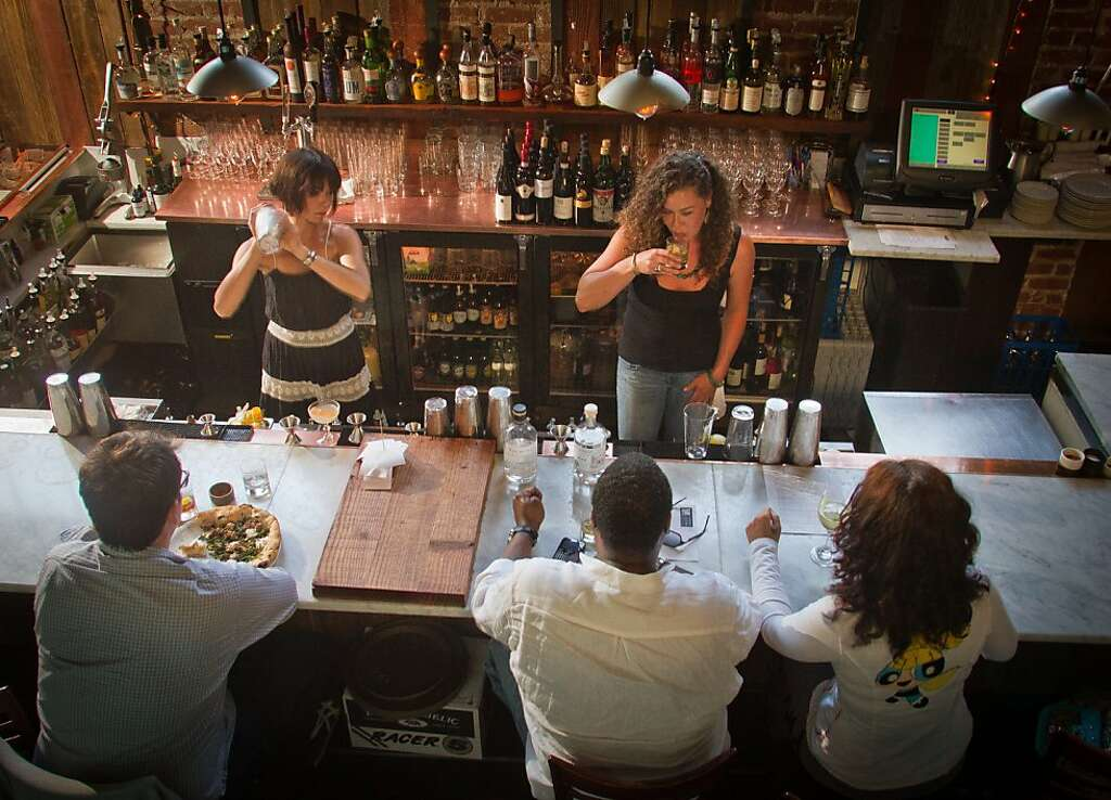 Bartenders Make Drinks For Customers At Boot And Shoe Service Restaurant In  Oakland, Calif.