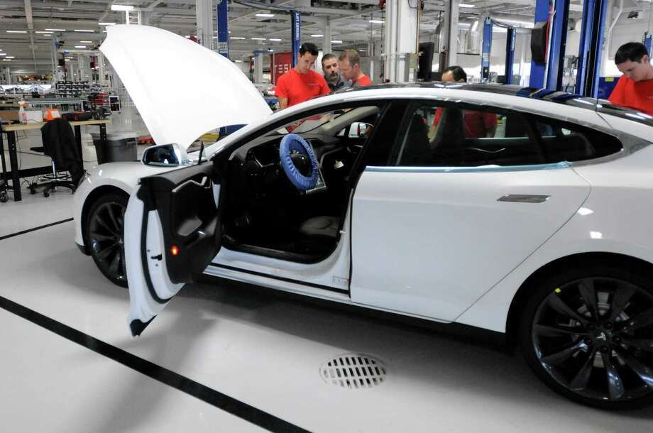A completed Tesla Model S sedan sits at the end of the assembly line at Tesla's factory in Fremont, Calif., Wednesday, June 13, 2012. On June 22, Tesla Motors will begin delivering its all-electric Model S luxury sedan. It is only the second car ever produced by Tesla, and first to be built at Tesla's own factory. Photo: Erik Verduzco, Special To The Chronicle / ONLINE_YES