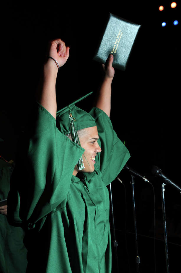 Jose Febus celebrates after receiving his diploma during graduation exercises for the Bassick High School Class of 2012, held at the Klein Memorial Auditorium, in Bridgeport, Conn., June 19th, 2012. Photo: Ned Gerard / Connecticut Post