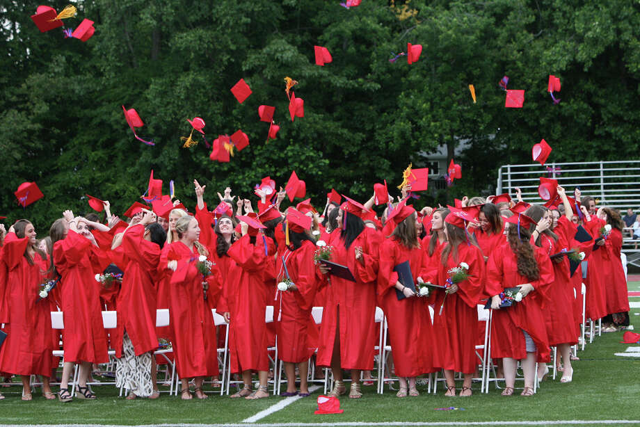 Joseph A. Foran High School graduates throw their caps in the air after their commencement  ceremony in Milford, Conn. on June 19. 2012. Photo: B.K. Angeletti / Connecticut Post
