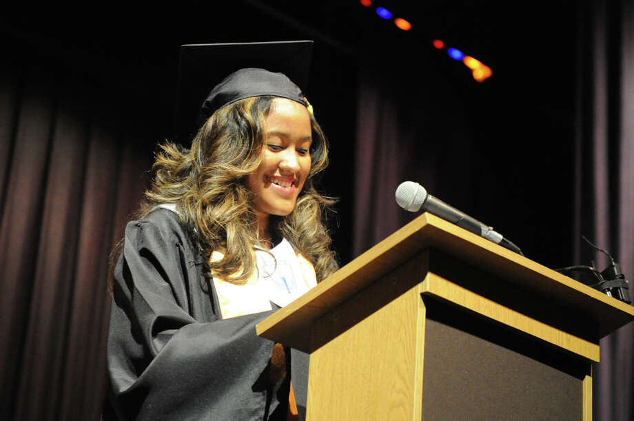 Fernanda Denys Reyes takes center stage during the Academy of Information Technology and Engineering Class of 2012 Commencement at Rippowam School in Stamford, Conn., June 19, 2012. Photo: Keelin Daly / Stamford Advocate