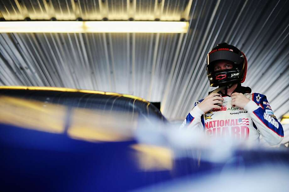 LONG POND, PA - JUNE 08:  Dale Earnhardt Jr., driver of the #88 National Guard / Diet Mountain Dew Chevrolet, puts his helmet on before the start of practice for the NASCAR Sprint Cup Series Pocono 400 at Pocono Raceway on June 8, 2012 in Long Pond, Pennsylvania.  (Photo by Jared C. Tilton/Getty Images) Photo: Jared C. Tilton, Getty Images