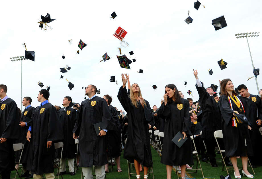 Graduates toss their caps into the air during Trumbull High School's Class of 2012 Commencement Exercises in Trumbull, Conn. on Tuesday June 19, 2012. Photo: Christian Abraham / Connecticut Post