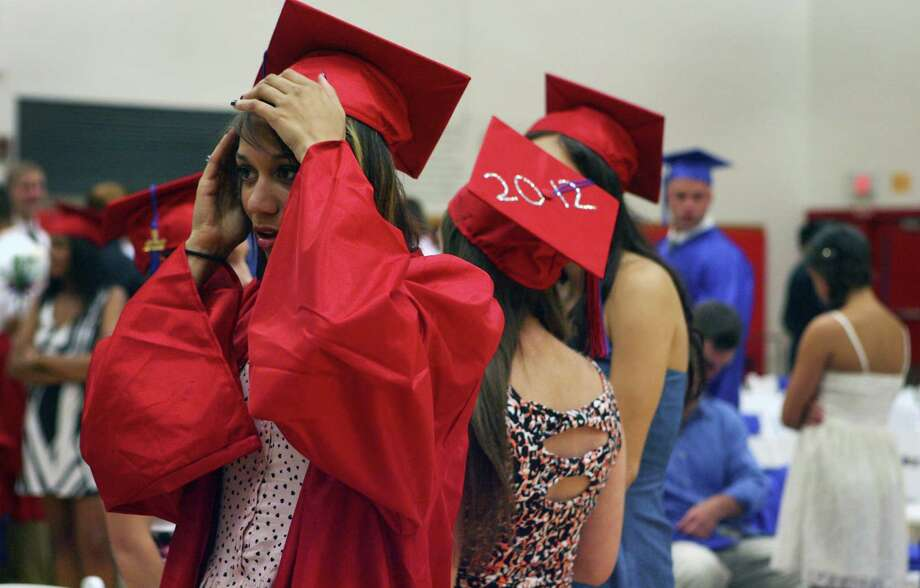 Graduate Kismet Debnam fixes her cap before the Joseph A. Foran High School commencement ceremony in Milford, Conn. on June 19. 2012. Photo: B.K. Angeletti / Connecticut Post