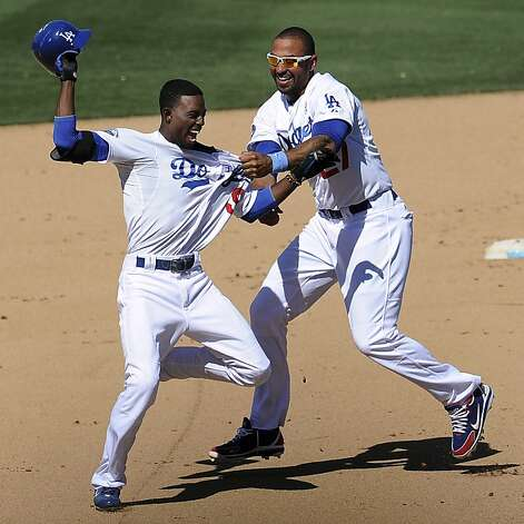 Los Angeles Dodgers' Dee Gordon, left, is tackled by Matt Kemp (27) after Gordon's winning RBI single in the 10th inning of a baseball game against the Chicago White Sox, Sunday, June 17, 2012, in Los Angeles. The Dodgers won 2-1. (AP Photo/The Pasadena Star-News, Keith Birmingham)  MAGS OUT; NO SALES; MANDATORY CREDIT Photo: Keith Birmingham, Associated Press
