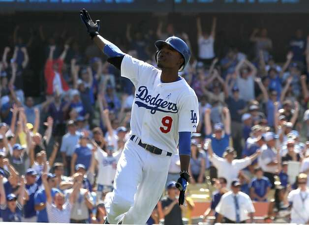 LOS ANGELES, CA - JUNE 17:  Dee Gordon #9 of the Los Angeles Dodgers celebrates as he runs to first after hitting a game winning walk off single in the tenth inning against the Chicago White Sox in interleage play on June 17, 2012 at Dodger Stadium in Los Angeles, California.  The Dodgers won 2-1 in ten innings.  (Photo by Stephen Dunn/Getty Images) Photo: Stephen Dunn, Getty Images