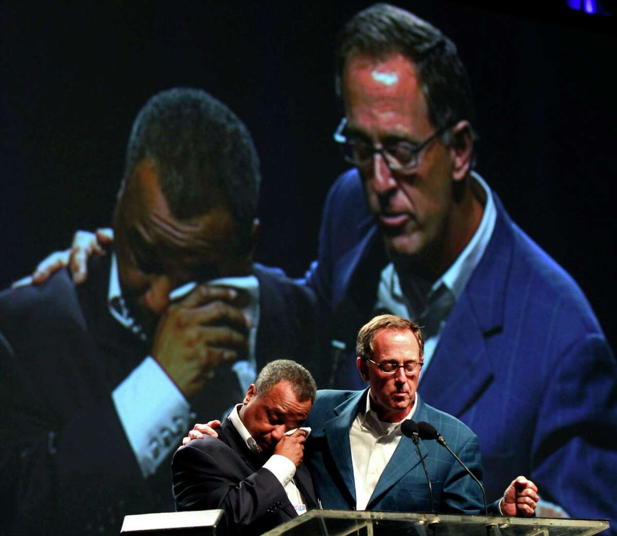 Fred Luter, Pastor of the Franklin Ave. Baptist Church in New Orleans, right, wipes away tears as he is elected as president of the Southern Baptist Convention, at the convention in New Orleans, Tuesday, June 19, 2012. Luter is the first African-American to be elected president of the nation's largest Protestant denomination. Right is current president Bryant Wright. (AP Photo/Gerald Herbert)