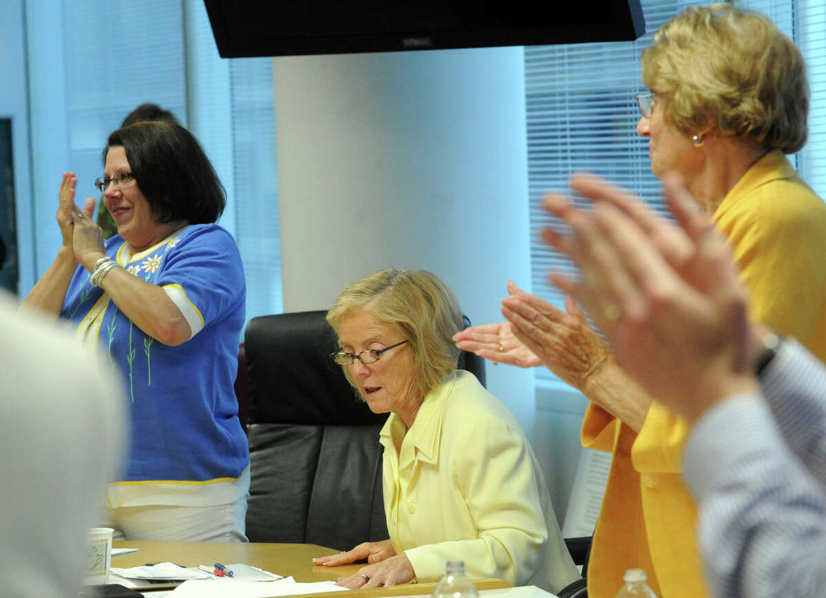 Winifred Hamilton receives a standing ovation after the Stamford Board of Education voted her in as the new superintendent of schools at the Government Center in Stamford, Conn., June 19, 2012. . Board president Polly Rauh, right, introduced last-minute agenda item to try to block the vote.
