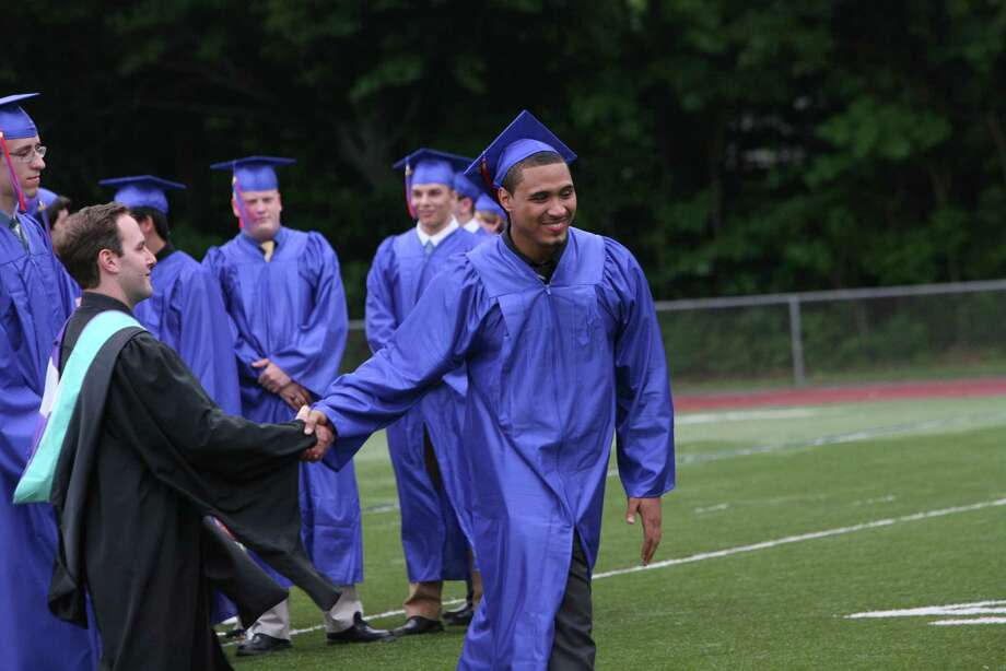 Graduate Eric Stewart  goes up to receive his diploma during the Joseph A. Foran High School commencement ceremony in Milford, Conn. on June 19. 2012. Photo: B.K. Angeletti / Connecticut Post