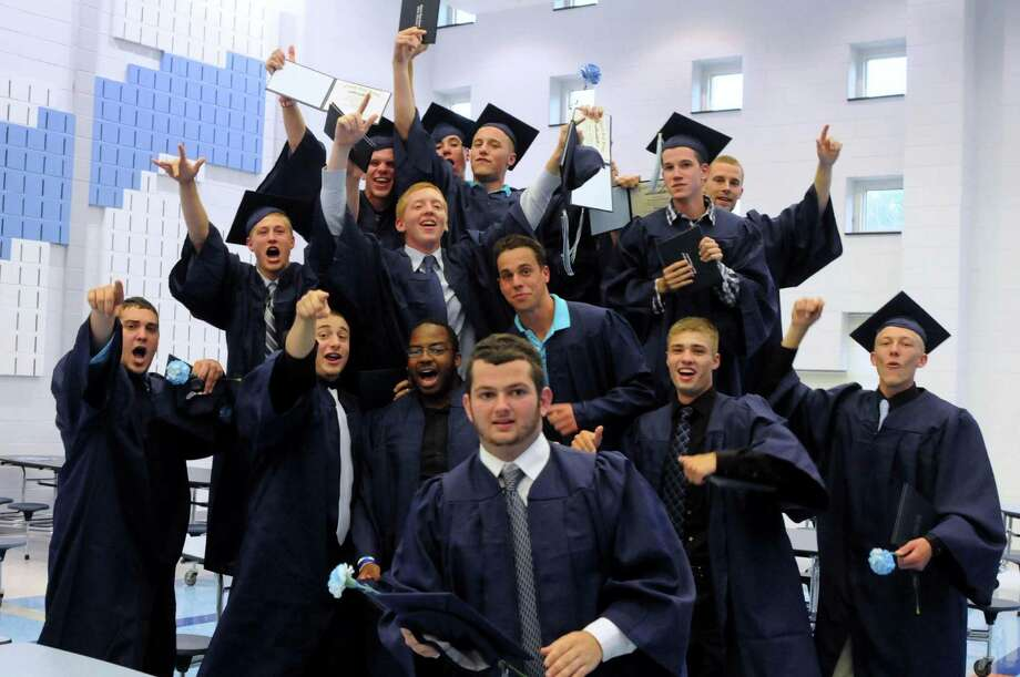 Graduates celebrate after the Oxford High School graduation ceremony at the campus in Oxford, Conn. on Tuesday June 19, 2012. Photo: Lisa Weir / Connecticut Post Freelance