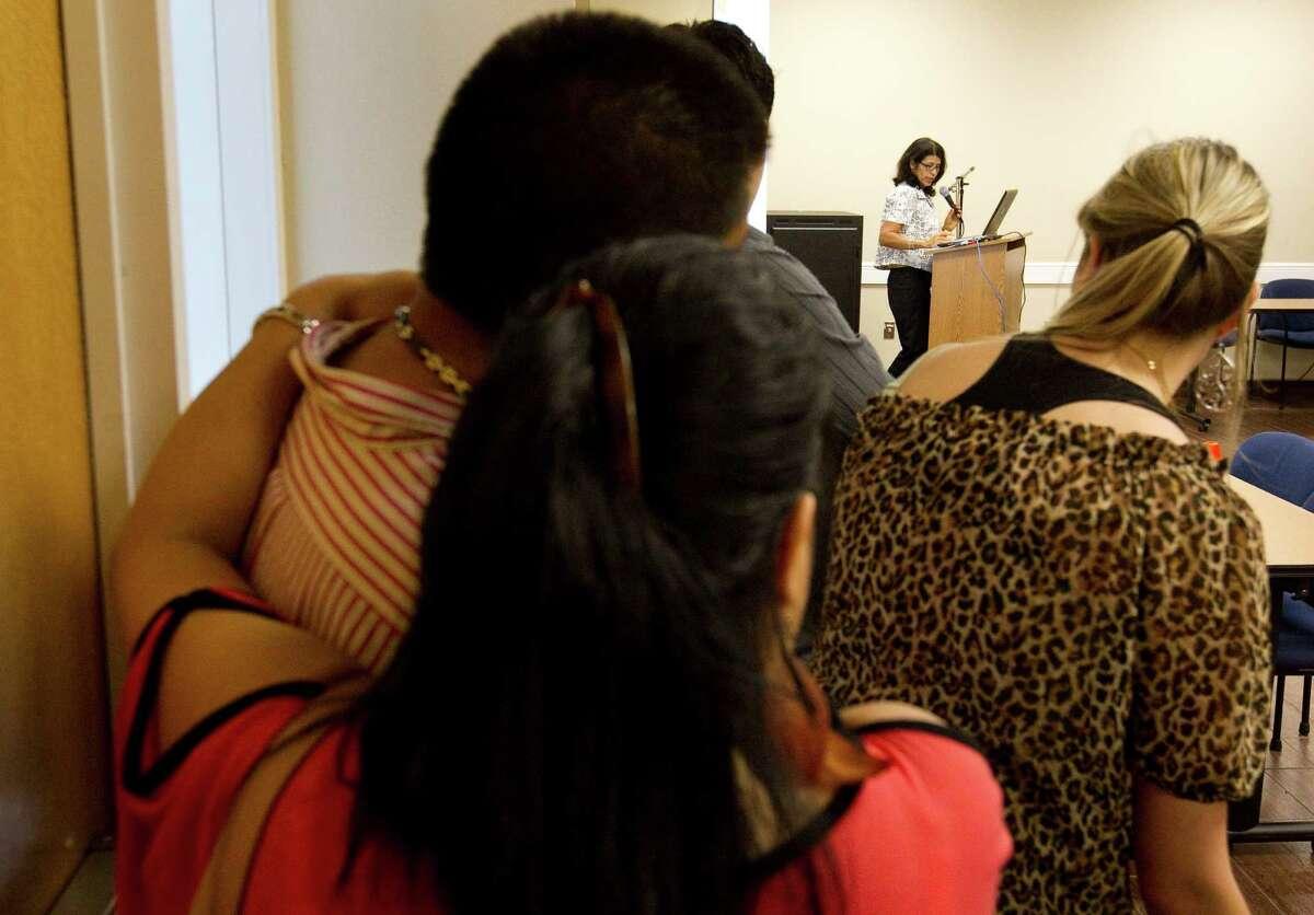 Toni Alvarenga-Watkins, of Catholic Charities of the Archdiocese of Galveston-Houston, speaks at a charla on Tuesday in Houston.