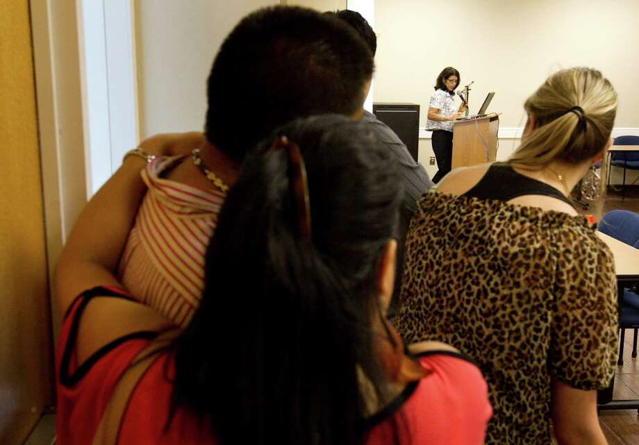 Toni Alvarenga-Watkins, of Catholic Charities of the Archdiocese of Galveston-Houston, speaks at a charla on Tuesday in Houston. Photo: Nick De La Torre / © 2012  Houston Chronicle
